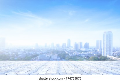Stone terrace and blurred city background