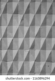 stone texture, concrete wall, diamond pattern. background ornament, beautiful pattern, Play of light and shadow, abstraction. Photo for advertising, image for your design.
