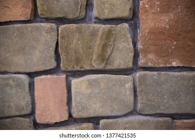 The stone texture with cracks and scratches can be used as a bac