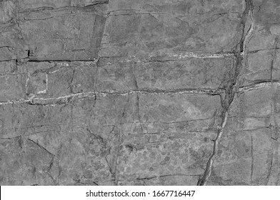 Stone texture. Stone old wall. Structural surface close-up. Granite natural surface. Texture pattern. Natural stone close-up. Selective focus and artificial noise in the photo.