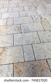 stone tile on the sidewalk, vertical image