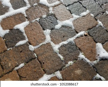 stone tiles and snow