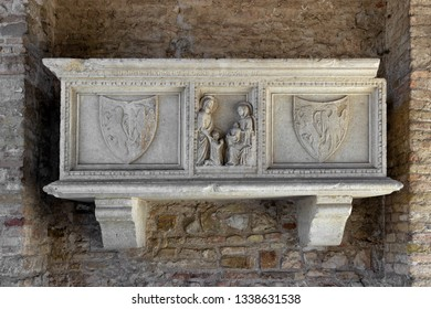 Stone tomb at the entrance of the famous basilica of Aquileia