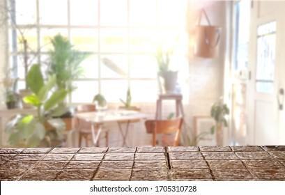 Stone top table indoor. Blurred indoor garden background. mockup workspace