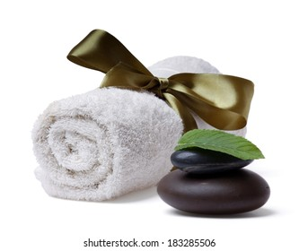 Stone, towel and leaf of mint, isolated on white background
