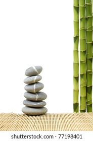 Stone tower with green bamboo grove on bamboo stick straw mat
