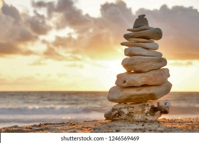 A stone tower at the sea with sunset