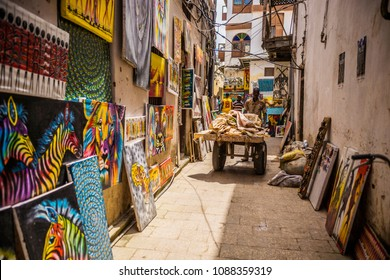 STONE TOWN, TANZANIA - January 2018: Stone town cityscape, people on the street of Stone Town, Zanzibar. Narrow streets and old houses, Zanzibar, Tanzania