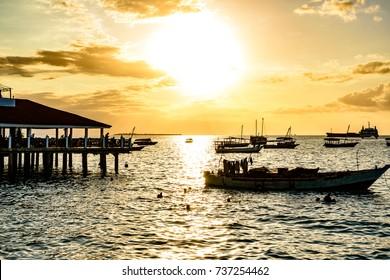 STONE TOWN, ZANZIBAR - August 13: Sunset of Stone Town in Zanzibar, Tanzania on August 13, 2017. Zanzibar is a semi-autonomous region of Tanzania in East Africa.