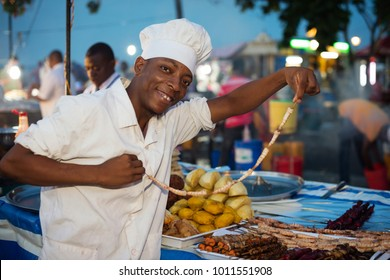 STONE TOWN, ZANZIBAR - DEC 31, 2017: Man selling street food at Forodhani Garden in Stone Town, Zanzibar