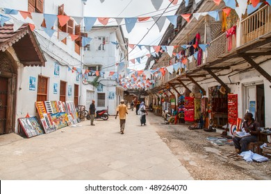 STONE TOWN, ZANZIBAR - February 15, 2016: Local people on a street in Stone Town. Stone Town is the old part of Zanzibar City, the capital of Zanzibar, Tanzania