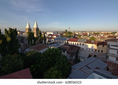 stone town zanzibar rooftop view over town with cathedral towers in sight