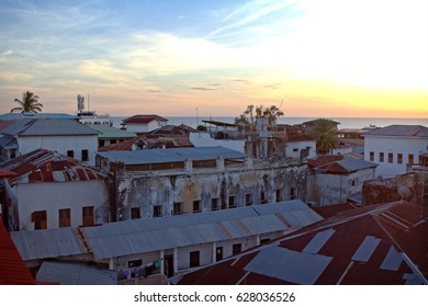 stone town zanzibar rooftop view over town with old rustic walls at sunset