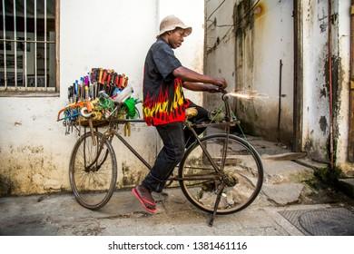 Stone town, Zanzibar / Tanzania - August 13th 2017: Knife sharpener on the streets of Stone town Zanzibar. Bicycle turn to knife sharpener when padal reverse.