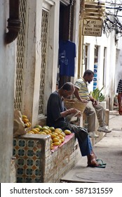 STONE TOWN, ZANZIBAR, TANZANIA - CIRCA JANUARY 2014: People in an alley in the old section of Stone Town