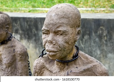 Stone Town, Zanzibar, Tanzania, Jul 08, 2016: Monument to slaves near former slave trade market. Sculpture of slave near Anglican Cathedral Church of Christ in Stone Town, Zanzibar, Tanzania