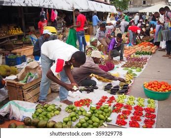 Stone Town, Zanzibar, Tanzania - November 25th 2015: One man working at his fruit stall in Darajani market in Stone town.