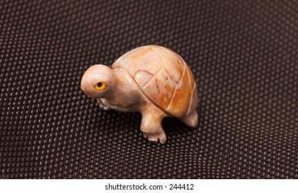 Stone Turtle on Black Fabric