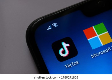 Stone / UK - August 2 2020: TikTok and Microsoft deal concept photo. TikTok and Microsoft apps on the mobile screen. Concept for potential Tik Tok buyout.