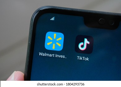 Stone / UK - August 28 2020: TikTok and Walmart deal concept photo. TikTok and Walmart Investors apps on the mobile screen. Concept for potential Tik Tok buyout.