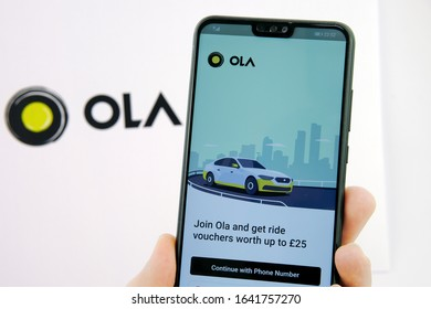 Stone / United Kingdom - February 10 2020: Ola cabs app login screen on the smartphone an the company logo on the blurred background. Ola Cabs is a ride sharing company.