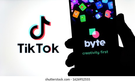 Stone / United Kingdom - January 26 2020: Byte app on the silhouette of smartphone and TikTok logo on a blurred background screen. Byte is the sequel to Vine app. Real photo, not a montage.