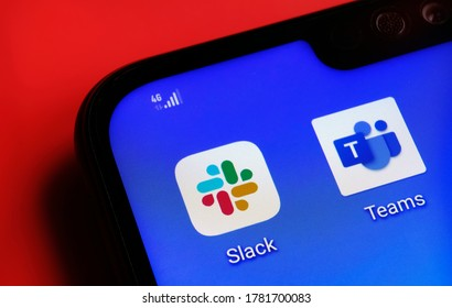 Stone / United Kingdom - July 22 2020: Slack and Microsoft Teams apps on the corner smartphone screen placed on red background. Concept for competition.