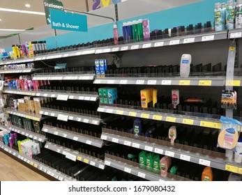 Stone / United Kingdom - March 21 2020: Empty supermarket shelves.  Aisle with shampoo and soap. Coronavirus panic buying at Morrisons supermarket, Staffordshire, UK.