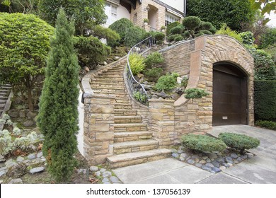 Stone Veneer Facade on Home Exterior with Manicured Front Entrance Yard Landscape