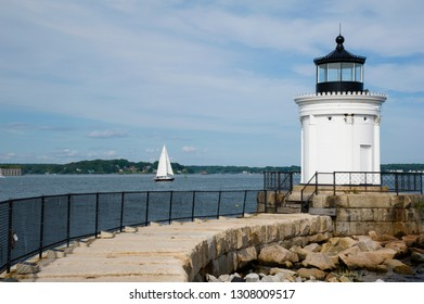 """Stone walkway leads up to Portland Breakwater lighthouse,  also to referred to as """"bug"""" light, as the beacon guides boats in the harbor. Its architecture has grecian influence."""