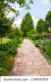 A stone walkway through the gardens at Mellon Park on a summer day, Pittsburgh, Pennsylvania, USA