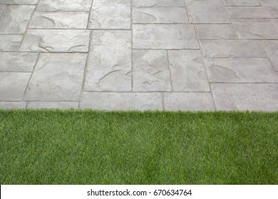 stone walkway,Stamped concrete with green grass.