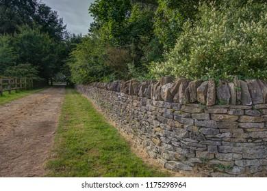 Stone wall along public bridle path.