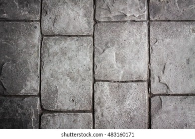 Stone wall background in monochrome. Old Ceramic tiles as abstract background. Concrete block wall. Old Wall brick. Detail of marble useful as a background. stone. block. Rock footpath with filter.