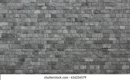 Stone wall as a background or texture. An example of masonry as a cladding of external walls.