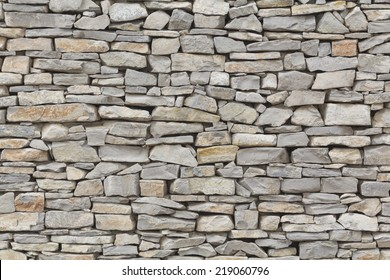 Stone wall background, traditional construction way