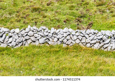 Stone wall in Burren way trail with Galway bay in background, Ballyvaughan, Clare, Ireland