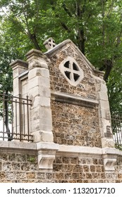 Stone Wall and Cross leading to the Basilica of the Sacré-Cœur in the Montmartre District of Paris France