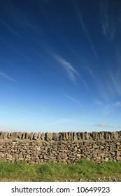 Stone wall with a deep blue sky