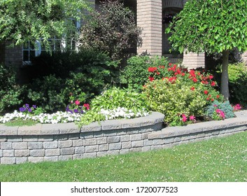 Stone wall design for home garden bed with multiple levels