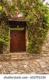 Stone wall with a door and plants