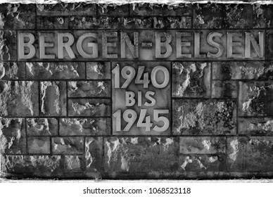 The stone wall at the entrance to Bergen Belsen Concentration Camp with the dates when it was in use
