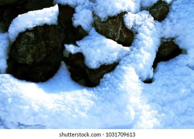 stone wall Falling snow