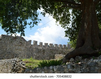 Stone wall of a fortress with skies