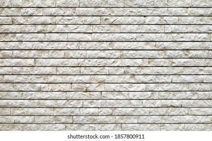 Steinmauer aus weißen Granitziegeln. Hintergrund und Textur