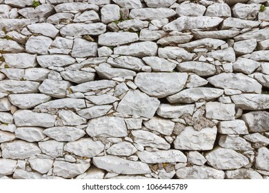 Stone wall made with white marble blocks