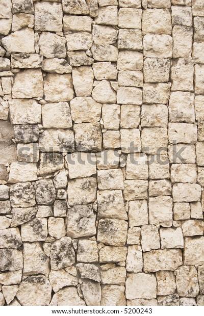 Stone wall made of yellowish limestone blocks