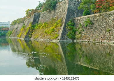 Stone wall and Moat of Osaka Castle.