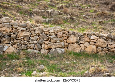 Stone wall in Mountain. Wadi Qelt valley in the West Bank, originating near Jerusalem and running into the Jordan River near Jericho and the Dead Sea. Nahal Prat, in Judaean Desert.