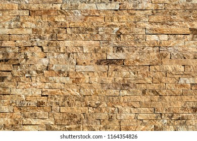Stone wall of natural stones in different sizes. The facade of the house.